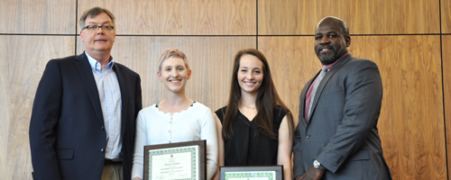 Department Head, Ken Korth, and Dean Deacue Fields presenting awards to two ENPL graduate students.